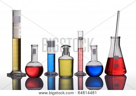A Laboratory Glassware With Blue,green And Red Liquid