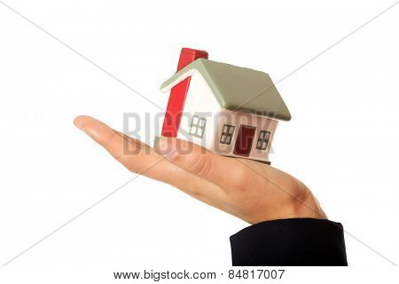 Young woman holding house model
