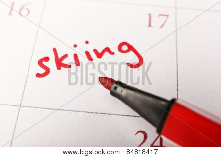 Written plan Skiing on calendar page background