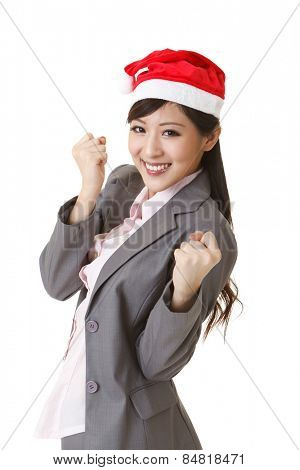 Cheerful business woman wearing Christmas hat, closeup portrait on white background.