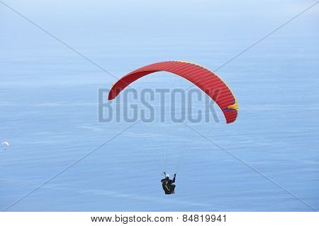 Paragliders fly over Indian ocean, Reunion.