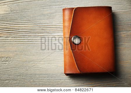 Hand made leather man wallet on wooden background