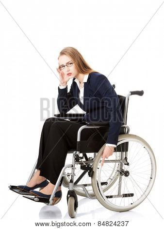 Tired caucasian businesswoman on a wheelchair