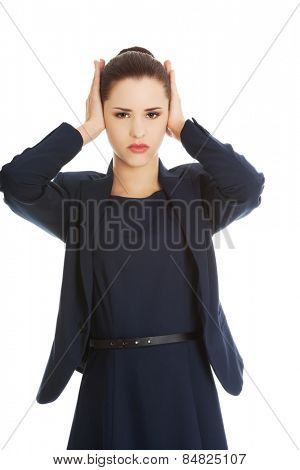 Young businesswoman with a headache