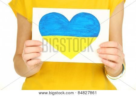 Hands holding paper heart with painted Ukraine flag, isolated on white