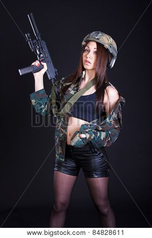Beautiful Young Woman In A Military Uniform With A Submachine Gun