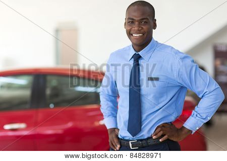 african american vehicle sales consultant inside showroom
