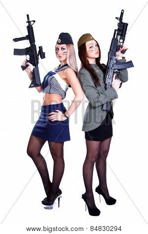 Two Women In The Marine And The Military Uniforms With The Assault Rifles