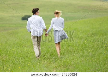 rear view of playful couple running outdoors