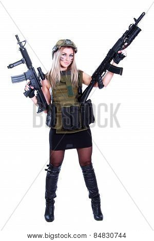 Woman In A Military Camouflage With Two Assault Rifles