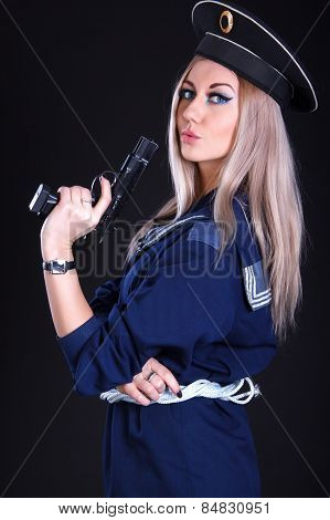 Beautiful Young Woman In A Marine Uniform With A Gun