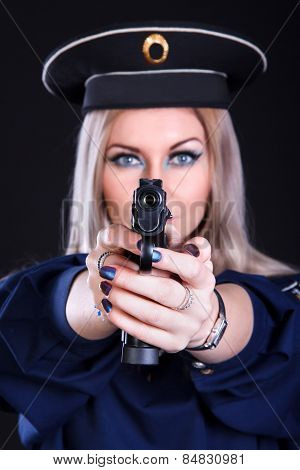 Beautiful Young Woman In A Marine Uniform With A Gun (focus Is On The Gun)