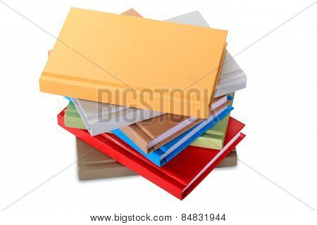 Close Up Of Stack Of Colorful Books On White Background.