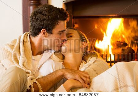 romantic young couple kissing in living room
