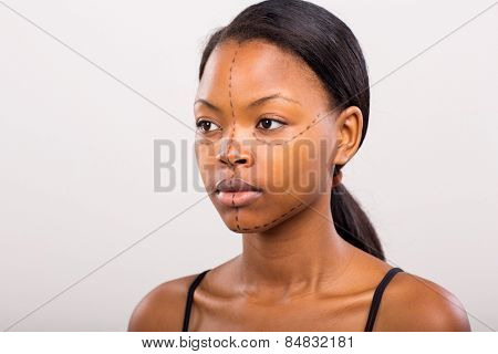 young african woman before plastic surgery on plain background