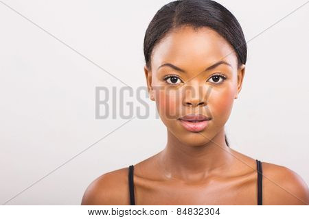 gorgeous african girl with natural makeup on plain background