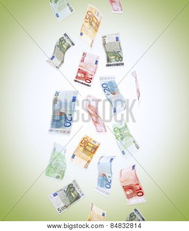 Flying Euro banknotes on green background