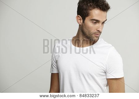 Mid adult man in white t-shirt studio