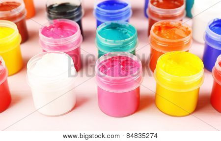Colorful paint on pink background
