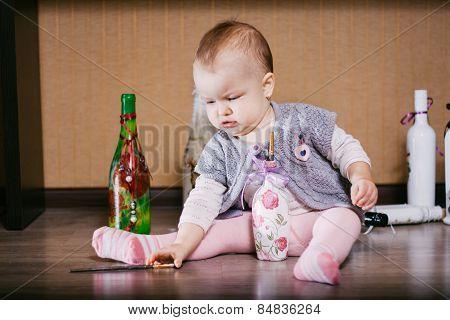 Child sitting playing bottle. decoupage