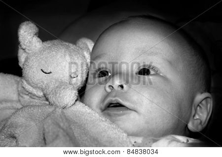 Baby with smile in black and white