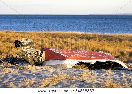 An old broken boat lying on a beach