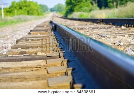 Train tracks fading towards the horizon