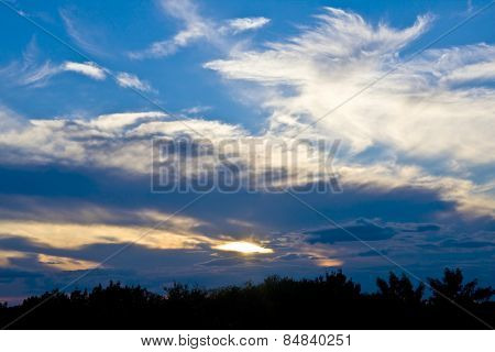 Beautiful sunset with vivid blue sky and light clouds