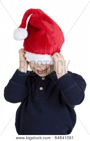 Handsome boy in santa claus hat isolated on white
