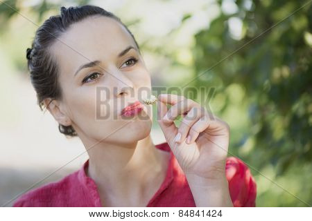 Beautiful Woman Eating White Mulberry