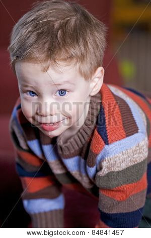 Cute young boy leaning forward and looking up