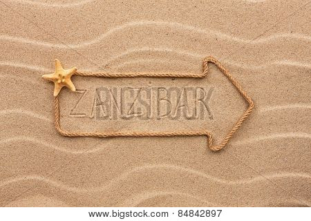 Arrow Made Of Rope And Sea Shells With The Word Zanzibar On The Sand