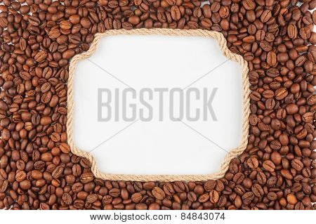 Figured Frame  Made Of Rope With  Coffee Beans  Lying On A White Background