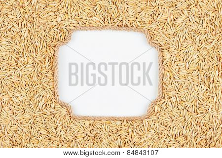 Figured Frame Made Of Rope With  Oats  Grains  Lying On A White Background