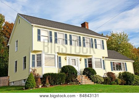 Yellow New England Style colonial house