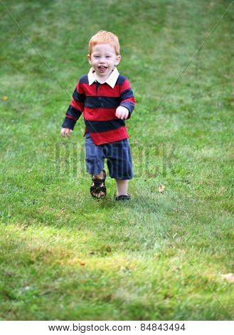 Happy boy running down hill