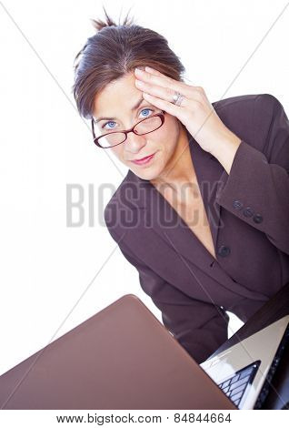 Stressed attractive brunette businesswoman isolated on white