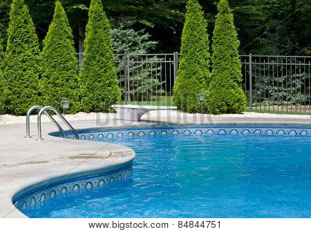 Generic small fenced swimming pool with diving board
