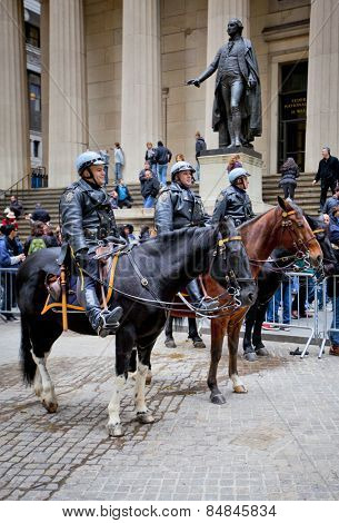 NEW YORK CITY - DEC 27: New York Police officers on horseback as part of the highly visible security on Wall Street outside the and Stock Exchange, December 27th, 2011 in Manhattan, New York City.