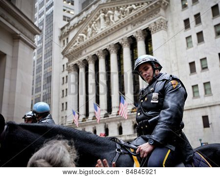 NEW YORK CITY - DEC 27: New York Police officers on horseback as part of the highly visible security on Wall Street outside the Stock Exchange, December 27th, 2011 in Manhattan, New York City.