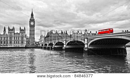 Red bus on Westminster Bridge by the Houses of Parliament