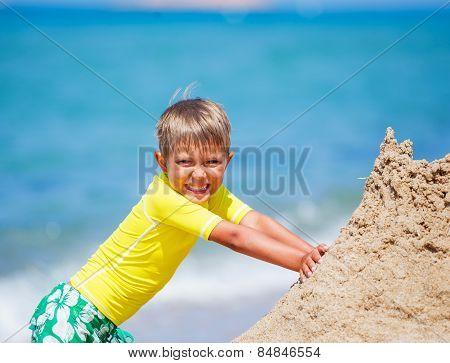 Boy playing on the beach