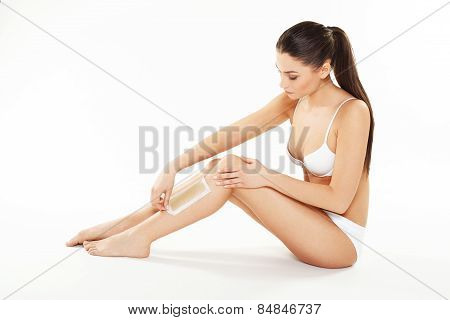 Young Woman Waxing Legs