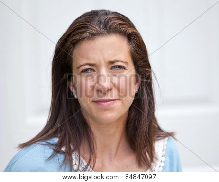 Pretty adult woman looking forward with sad expression