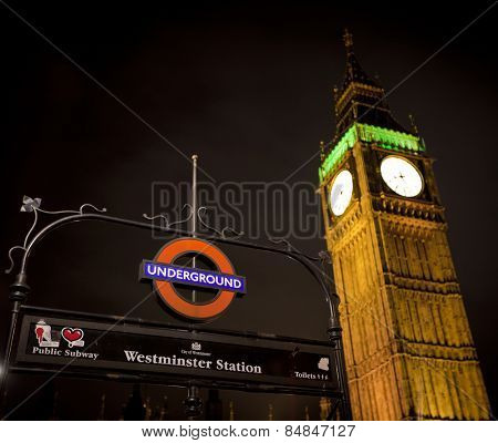 LONDON, ENGLAND FEB 17: London Underground subway sign in front of the famous Big Ben clock at Westminster on Feb 17, 2012 in London, United Kingdom.