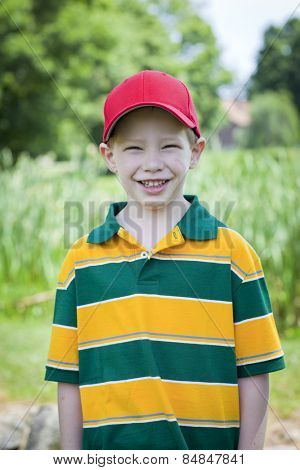 Cute boy with big smile outdoors summer portrait