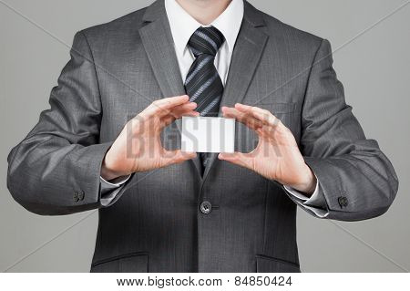 Businessman holds a business-card