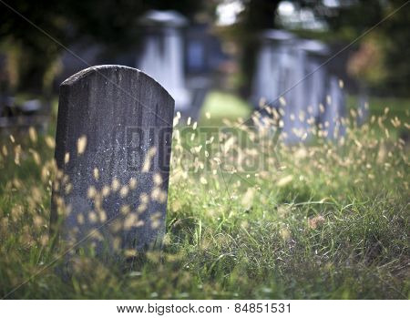 Tombstone and graves in an ancient church graveyard