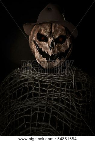 Pumpkin head halloween costume isolated on black