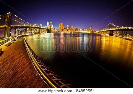 Manhattan Bridge and Brooklyn Bridge with Manhattan skyline At Night taken with fisheye lens